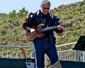 Kevin Volkan on guitar